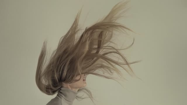 Young women with flying hair