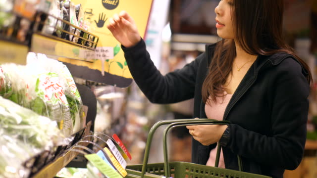 Youngwoman in supermarket supermarket,woman snack aisle stock videos & royalty-free footage