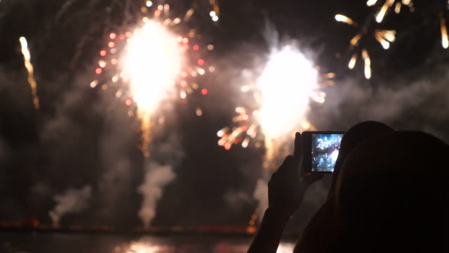Youngwoman record firework with smarphone event,firework bastille day stock videos & royalty-free footage