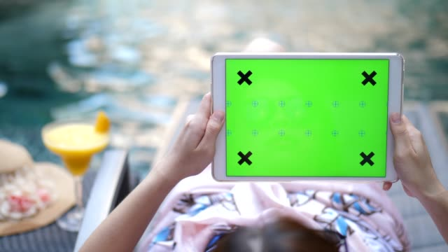 Youngwoman Relaxing  Digital Tablet on the Pool , Chroma key - Horizontal
