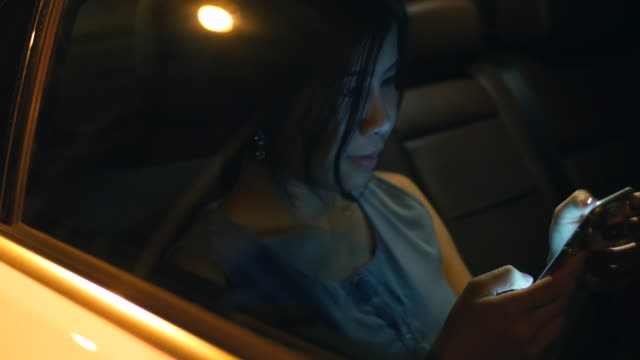 Youngwoman using phone in the Cars video