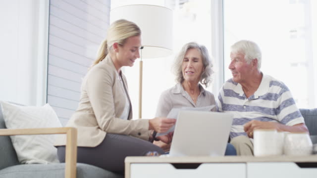 Your returns will work out better with this investment plan 4k video footage of senior couple having a consultation with a financial advisor at home financial planning stock videos & royalty-free footage