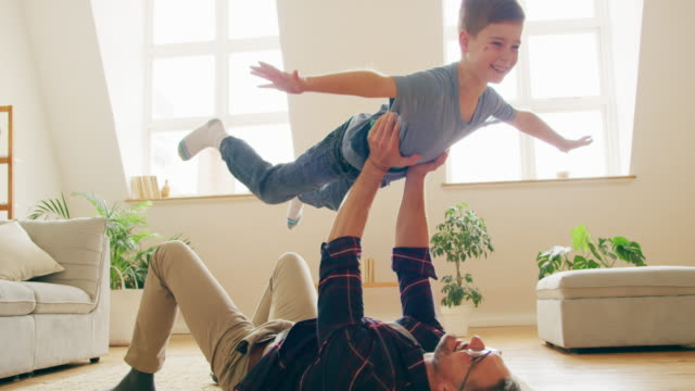 Your time is the best things you can give them 4k video footage of a father playing with his son wrestling stock videos & royalty-free footage