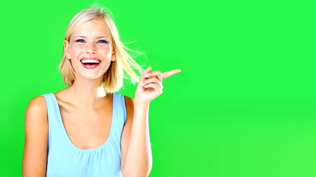 You're going to love this! High definition video of a beautiful young woman pointing at copyspace against a green screen pointing stock videos & royalty-free footage