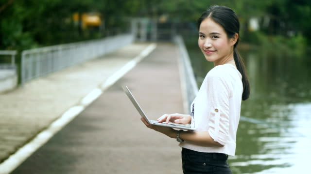 Youth Culture : Asian woman using note book video