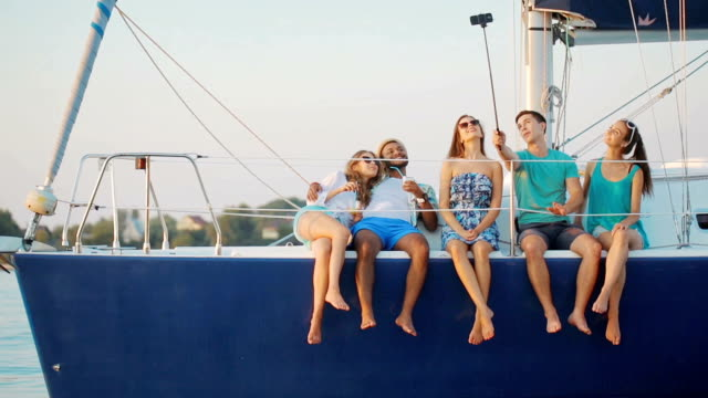 Youth makes selfie on a yacht. video