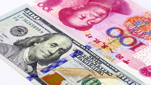 Yuan vs Dollar bank notes rotating concept business background Yuan vs Dollar bank notes rotating concept business background, loop ready china east asia stock videos & royalty-free footage