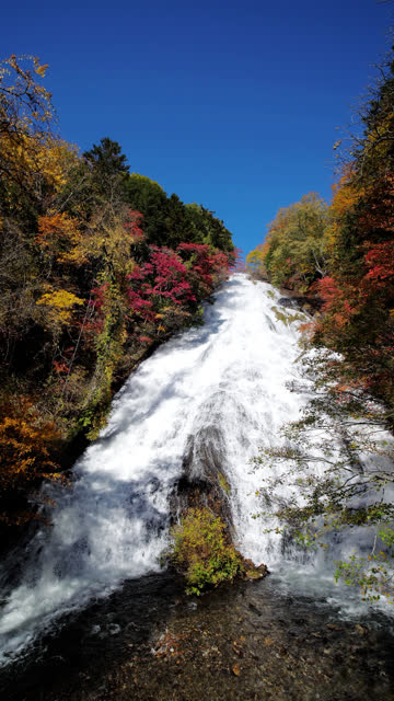 Yudaki Waterfall in Autumn with forest changed color at Nikko Japan , SLOW MOTION