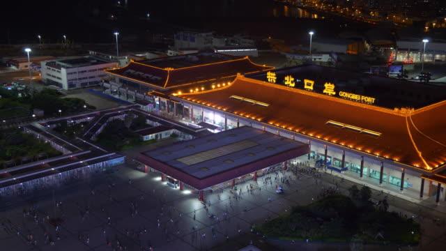zhuhai city night illuminated border port rooftop panorama 4k china - zhuhai video stock e b–roll
