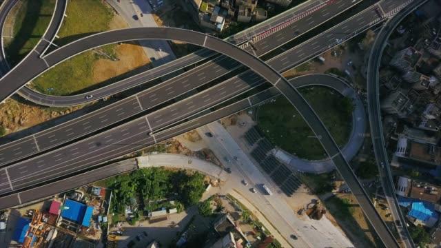 zhuhai city sunny day traffic road junction construction block aerial panorama 4k china - zhuhai video stock e b–roll