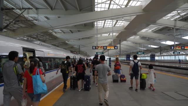 zhuhai city train station crowded platform slow motion panorama 4k china - zhuhai video stock e b–roll