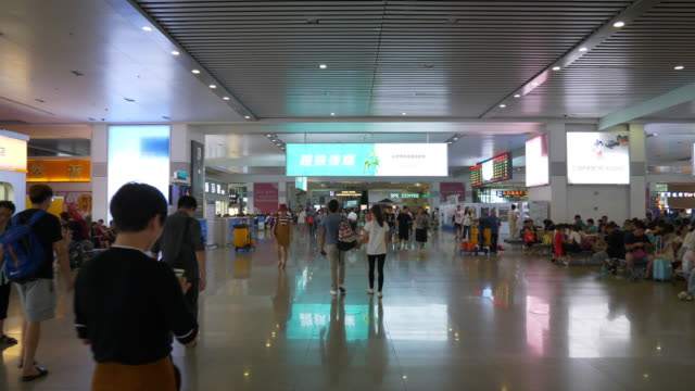 zhuhai city train station indoor hall slow motion panorama 4k china - zhuhai video stock e b–roll
