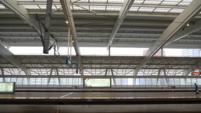 zhuhai city train station platform slow motion panorama 4k china - zhuhai video stock e b–roll
