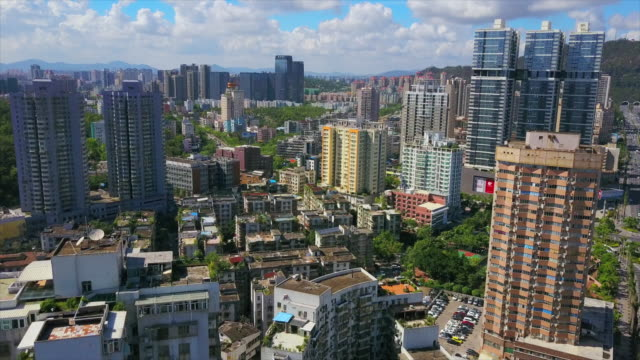 zhuhai cityscape sunny day apartment buildings aerial panorama 4k china - zhuhai video stock e b–roll
