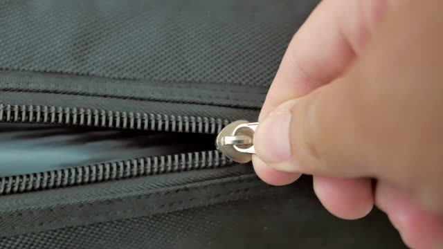 Zipping a zipper,Close-up video