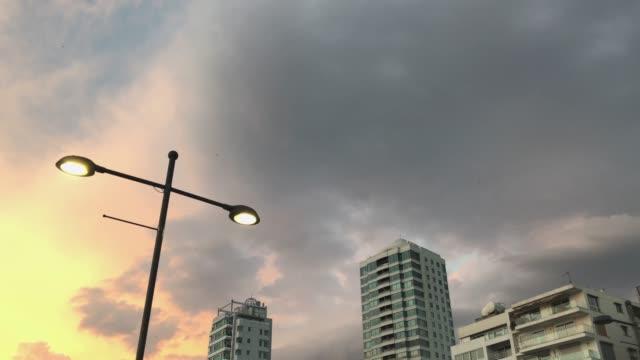 İzmir'de Gün Batımı ve Gökyüzü building, street light, sunset and sky aegean turkey stock videos & royalty-free footage