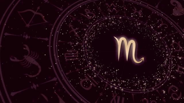 vídeos de stock e filmes b-roll de zodiac sign scorpio and horoscope wheel - astrologia
