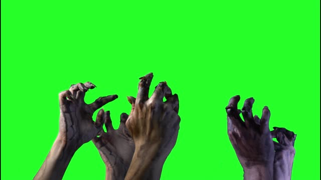 Zombie à la main sur un fond vert sur Halloween - Vidéo