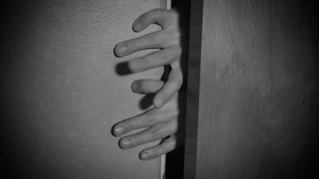 Zombie-like Fingers Try to Enter Room from Behind Closed Door video