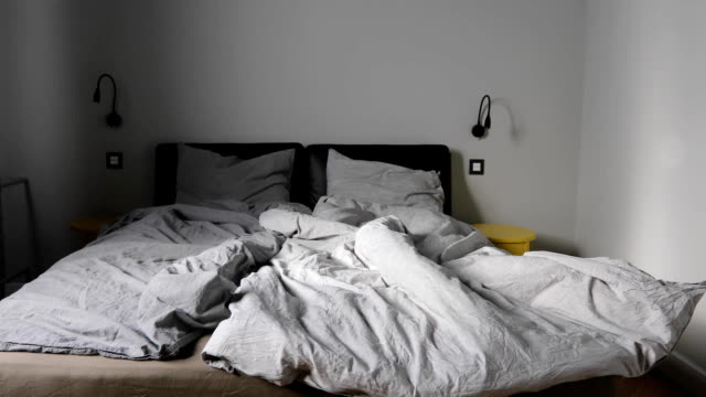 Zoom gray bedroom empty messy gray bed video