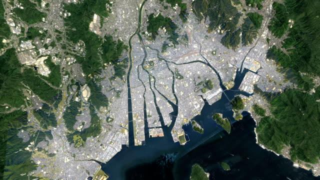 zoom in from space to japan hiroshima - hiroshima filmów i materiałów b-roll