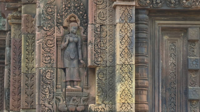 zoom in on a banteay srei devata in angkor region
