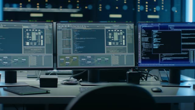 Zoom In on Multiple Personal Computer Monitors Showing Coding Language Program with System Monitoring Interface. In the Background Data Center with Server Racks. Zoom In on Multiple Personal Computer Monitors Showing Coding Language Program with System Monitoring Interface. In the Background Data Center with Server Racks. Shot on RED EPIC-W 8K Helium Cinema Camera. backup stock videos & royalty-free footage
