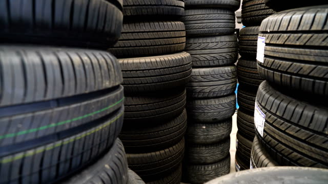 Zoom in Tires in auto parts store. 4K Zoom in Tires in auto parts store. tires stock videos & royalty-free footage