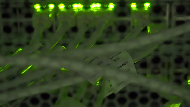 Zoom in UTP cables, blinking LED lights and RJ 45 on working Ethernet switches video