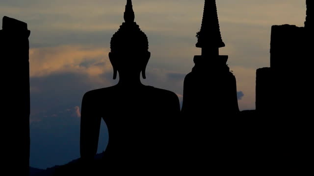 Zoom out Buddha and temple at Sunset Zoom out Buddha and temple at Sunset, Temple of Sukhothai province in Thailand. sukhothai stock videos & royalty-free footage