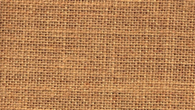 Zoom out closeup on sackcloth material video