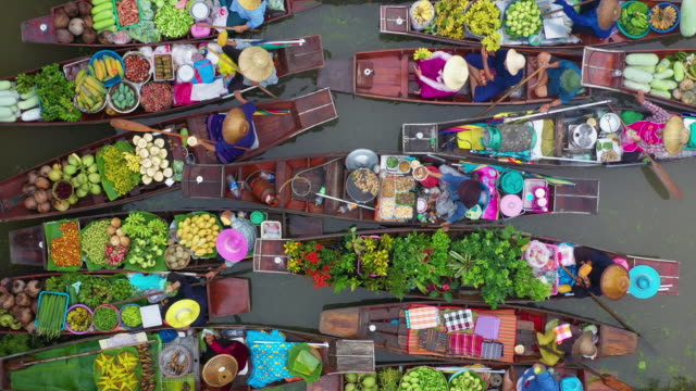 Zoom out of floating market Top view zoom out of floating market, This is traditional culture of Thailand, Popular and unseen for tourist, Location at Damnoen Saduak Floating Market, Thailand. souvenir stock videos & royalty-free footage
