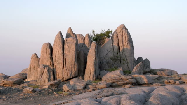 Zoom out on rock formations at Kubu Island, Botswana Zoom out on rock formations at Kubu Island, Botswana makgadikgadi pans national park stock videos & royalty-free footage