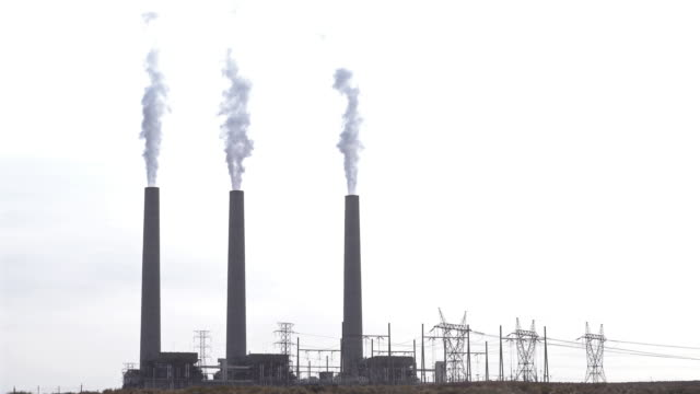 Zoom out Smoke from Chimney tower of Thermal coal Power plant in Page Arizona USA