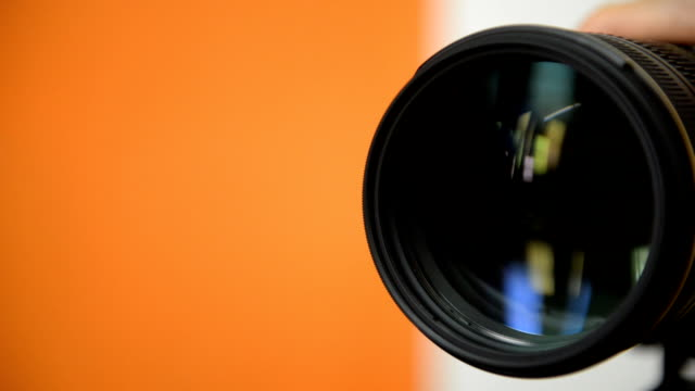 Zooming camera lens video