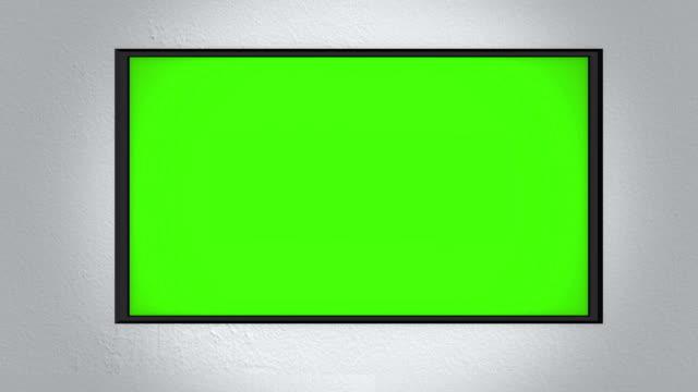 zoomning mot en vägg monterad 4k uhd tv på väggen - ultra high definition television bildbanksvideor och videomaterial från bakom kulisserna