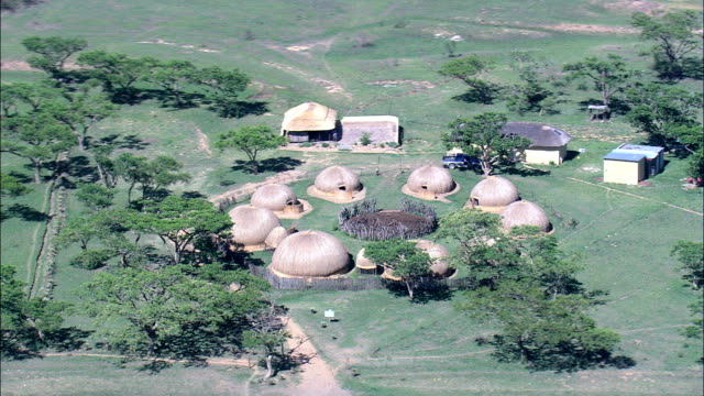 Zulu Kraal  - Aerial View - KwaZulu-Natal,  uMzinyathi District Municipality,  Msinga,  South Africa This clip was filmed by Skyworks on HDCAM SR 4:4:4 using the Cineflex gimbal. KwaZulu-Natal,  uMzinyathi District Municipality,  Msinga South Africa natal stock videos & royalty-free footage