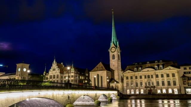 Zurich city skyline night timelapse at Fraumunster Church and Munster Bridge, Zurich, Switzerland, 4K Time lapse video