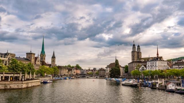 Zurich city skyline timelapse at Limmat River with Grossmunster and Fraumunster Church, Zurich, Switzerland, 4K Time lapse video